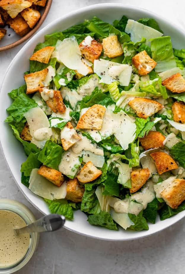 classic caesar salad served in a white bowl