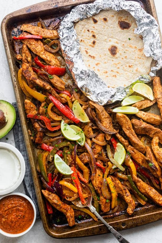 Chicken fajitas served on a sheet pan