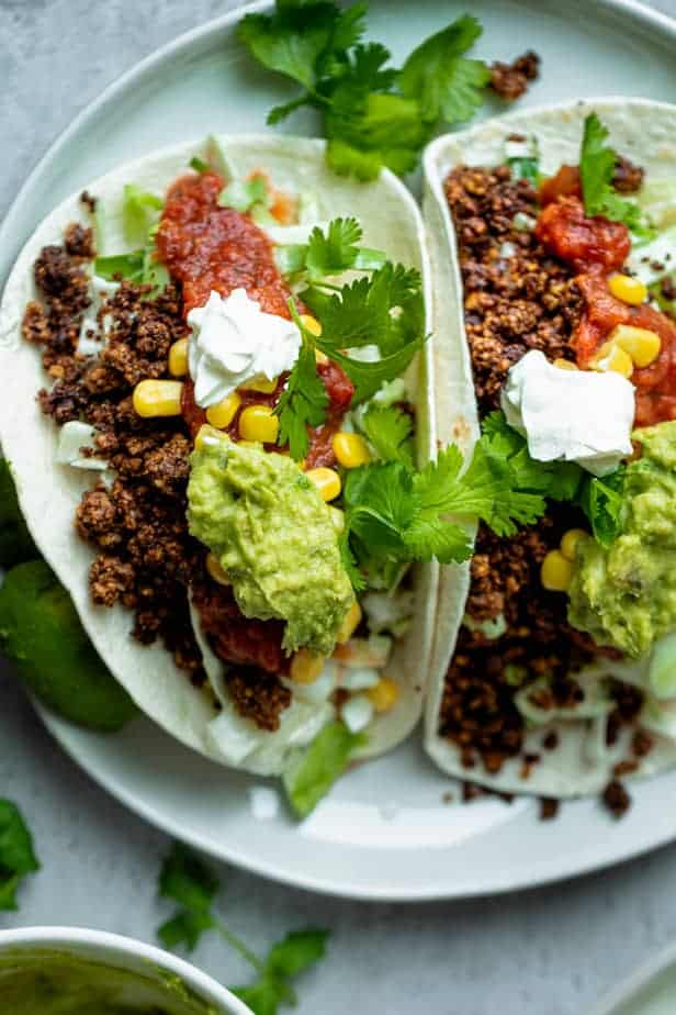 Walnut tacos topped with guacamole and salsa