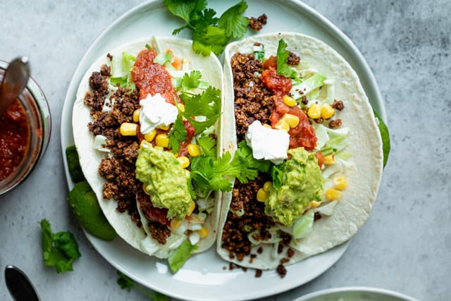 Tacos stuffed with the walnut mixture and toppings