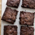 zucchini brownies cut into squares on a white background