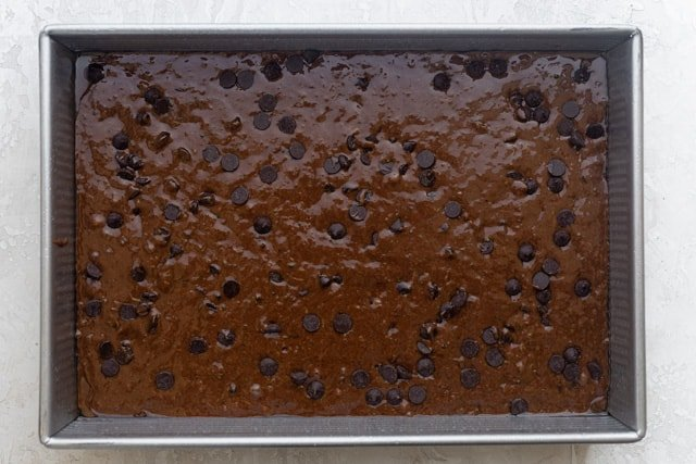 The brownie mixture in a baking pan