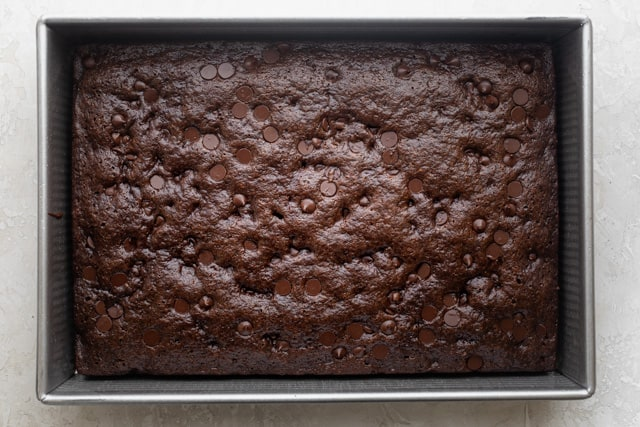 zucchini brownie uncut in a pan