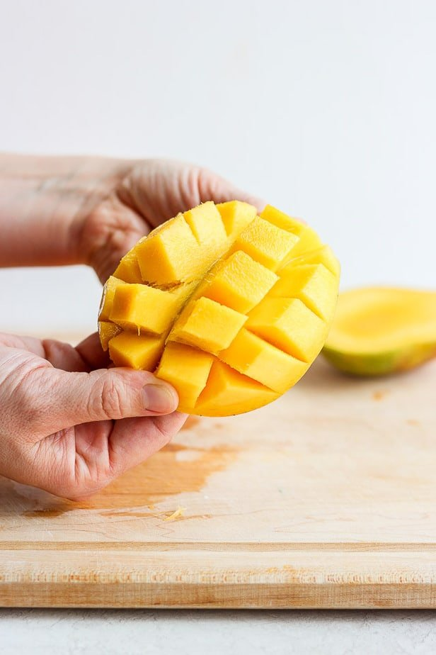 opening up a mango half