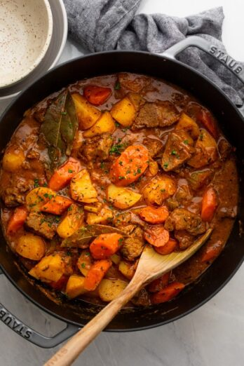 Beef stew in a large pot after it's done cooking