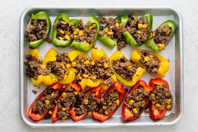 The filling on top of the bell peppers