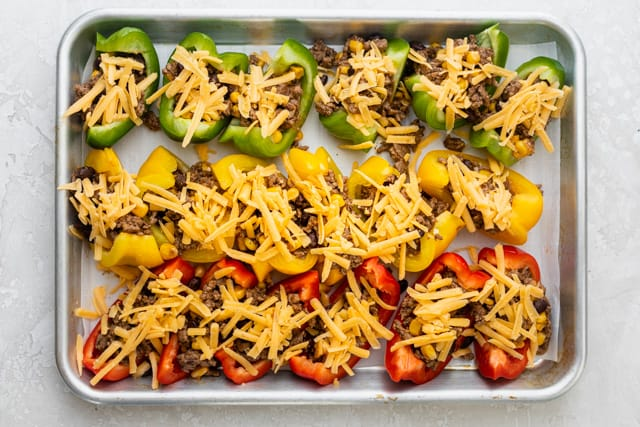 Shredded cheese topping the bell pepper nachos