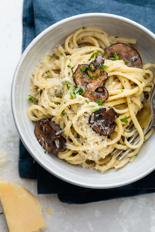 top down shot of creamy mushroom pasta in a bowl
