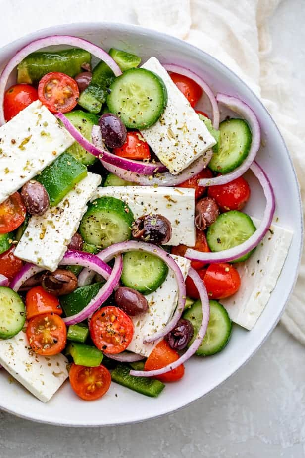 Close up shot of colorful Greek Salad with fresh vegetables