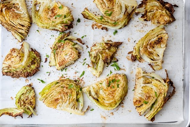 The cabbage after being roasted on a baking sheet