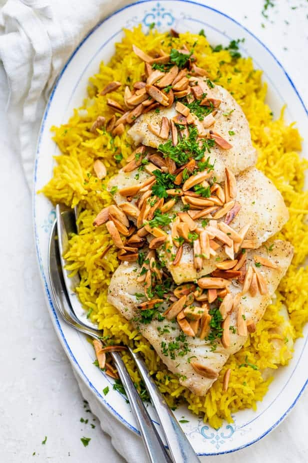 Lebanese rice and fish recipe - also known as sayadieh served on a platter with toasted almonds