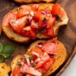 Tomato and basil brushetta on a wooden board