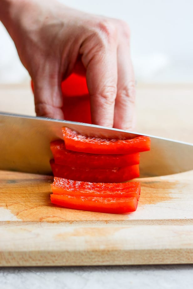 knife cutting pepper into slices