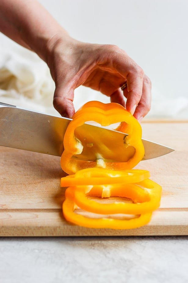 knife cutting a bell pepper into slices