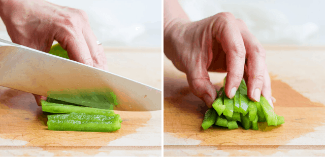 knife cutting bell pepper into strips