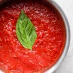 overhead shot of marinara sauce in a pot