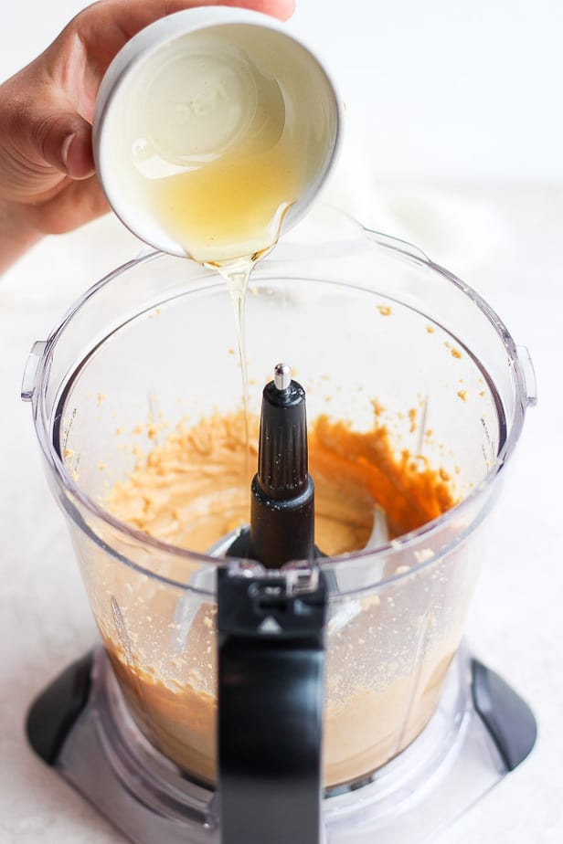 honey being poured into a blender