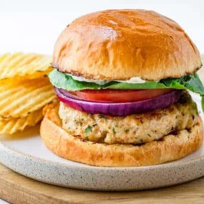 Ground chicken burger served with potato chips