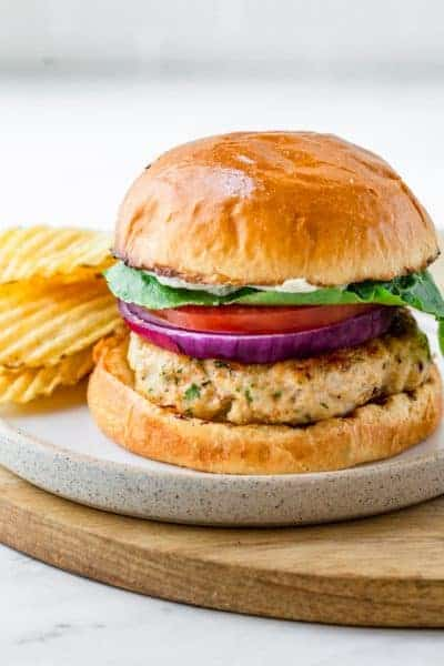 Ground chicken burger served with potato chips