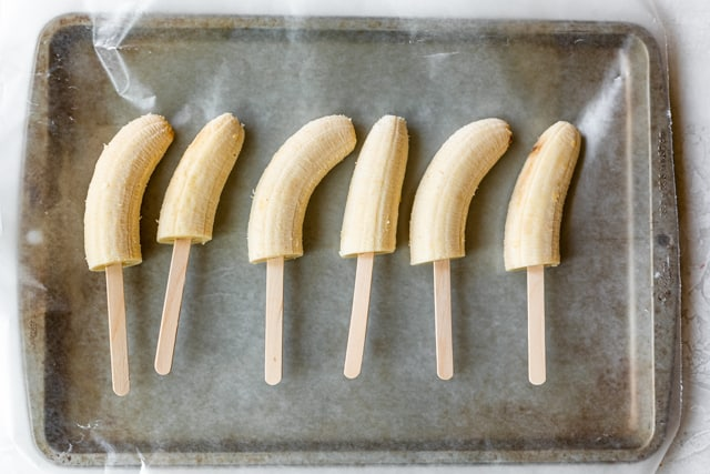 Banana halves on popsicle sticks