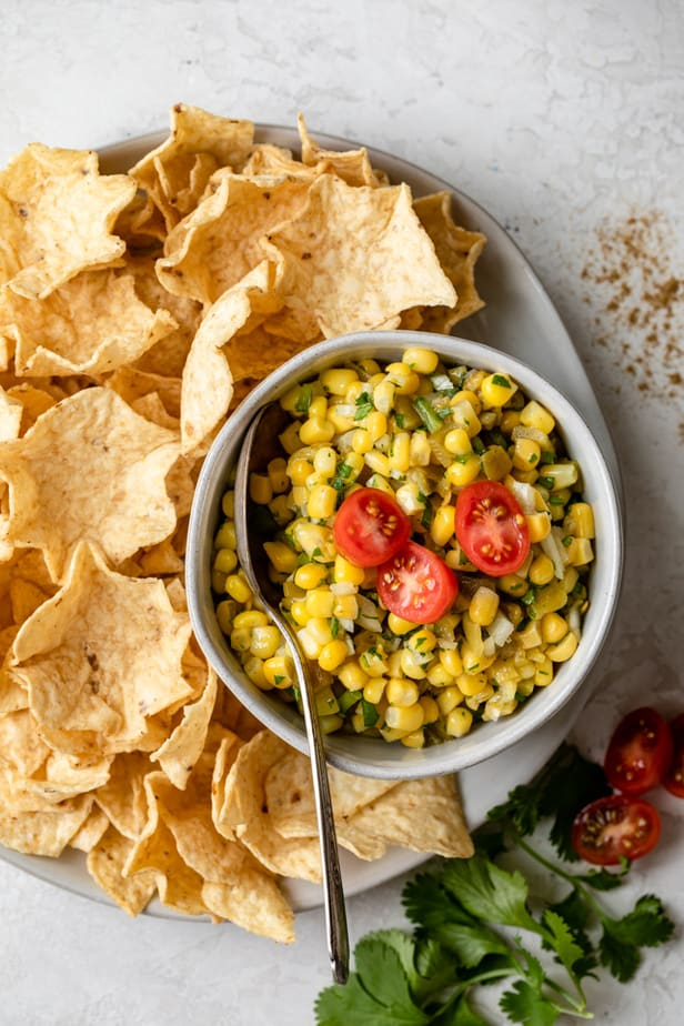 Corn salsa served with tortilla chips on the side