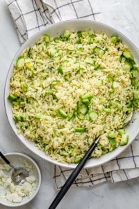 Large bowl of cucumber lemon orzo salad
