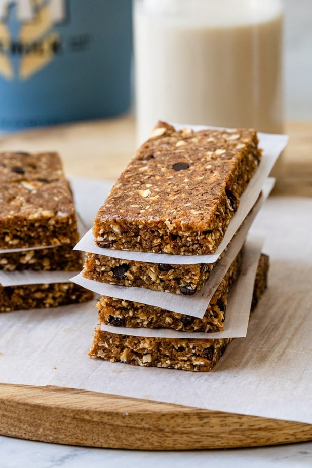 Protein bars stacked on top of each other with parchment paper in between