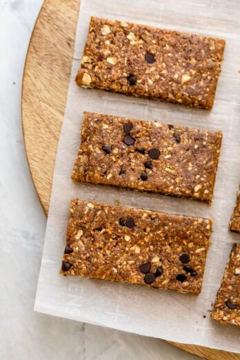 Close up shot of three vegan protein bars on parchment paper