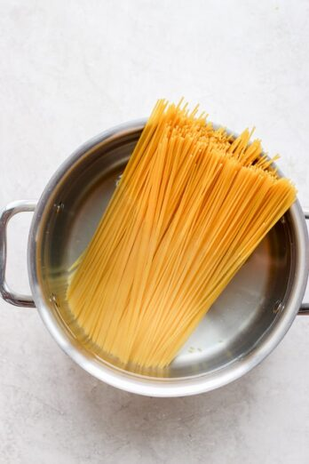 dried spaghetti in a pot with water
