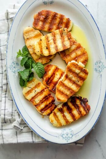 Grilled halloumi on platter with mint and olive oil