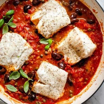 Tomato poached fish using cod along with olives an capers