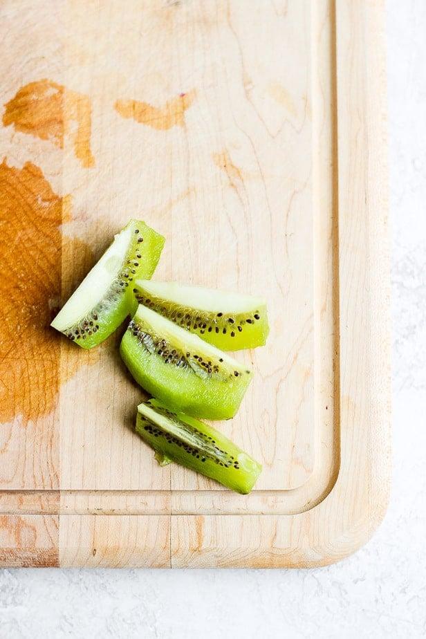 Wedges of kiwi on a cutting board