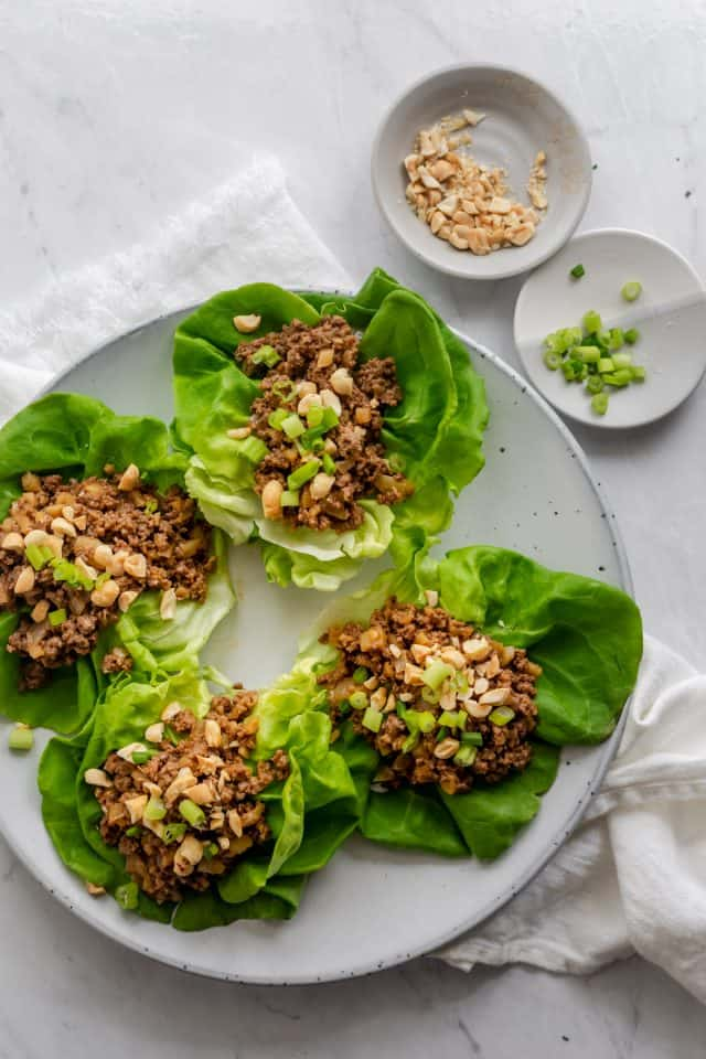 Asian lettuce wraps serve with peanuts and green onions
