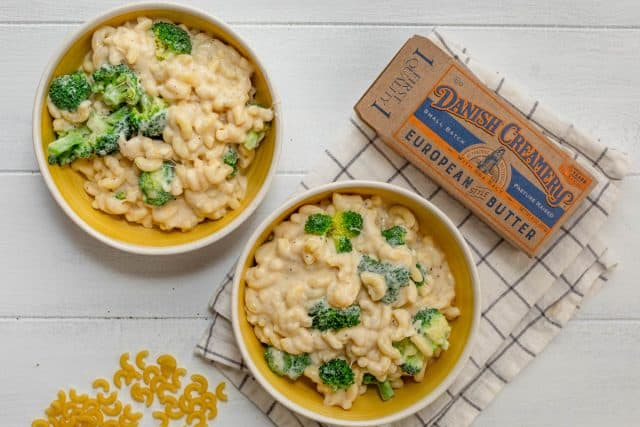 Two bowls of broccoli mac and cheese made with Danish creamery butter - pictured next to the bowls