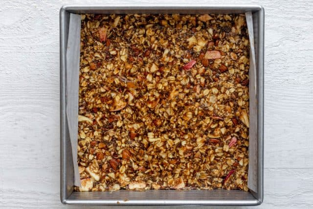 Granola pressed into square pan and chlilled