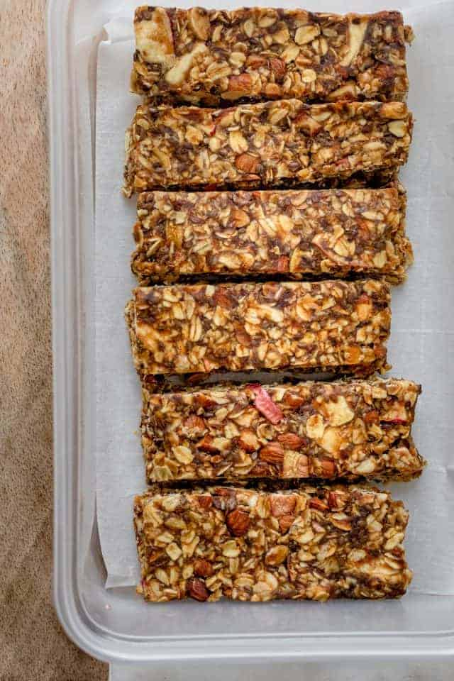 Caramel apple granola bars lined up on parchment paper