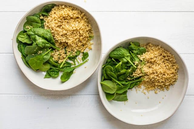 Two bowls of quinoa and spinach