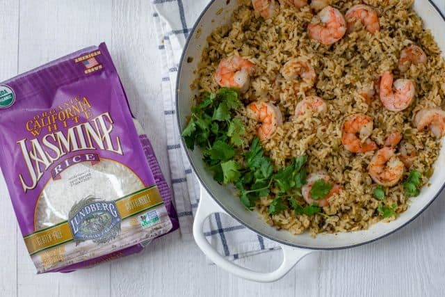Final one pan shrimp and rice recipe next to bag of Lundberg rice