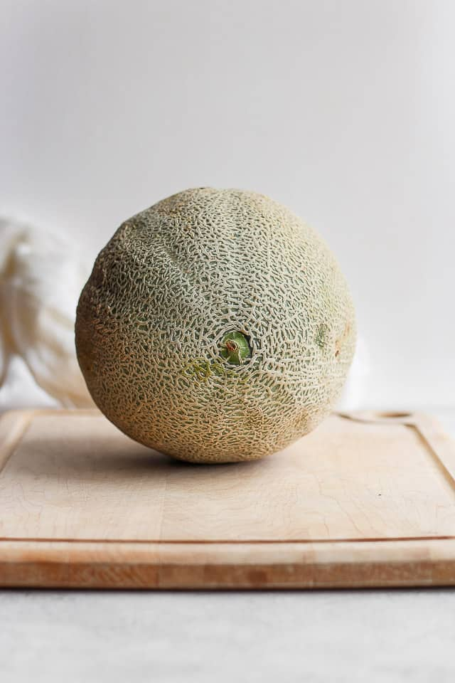 Large cantaloupe on cuttingboard