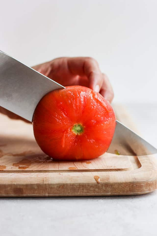 Cutting tomato in half