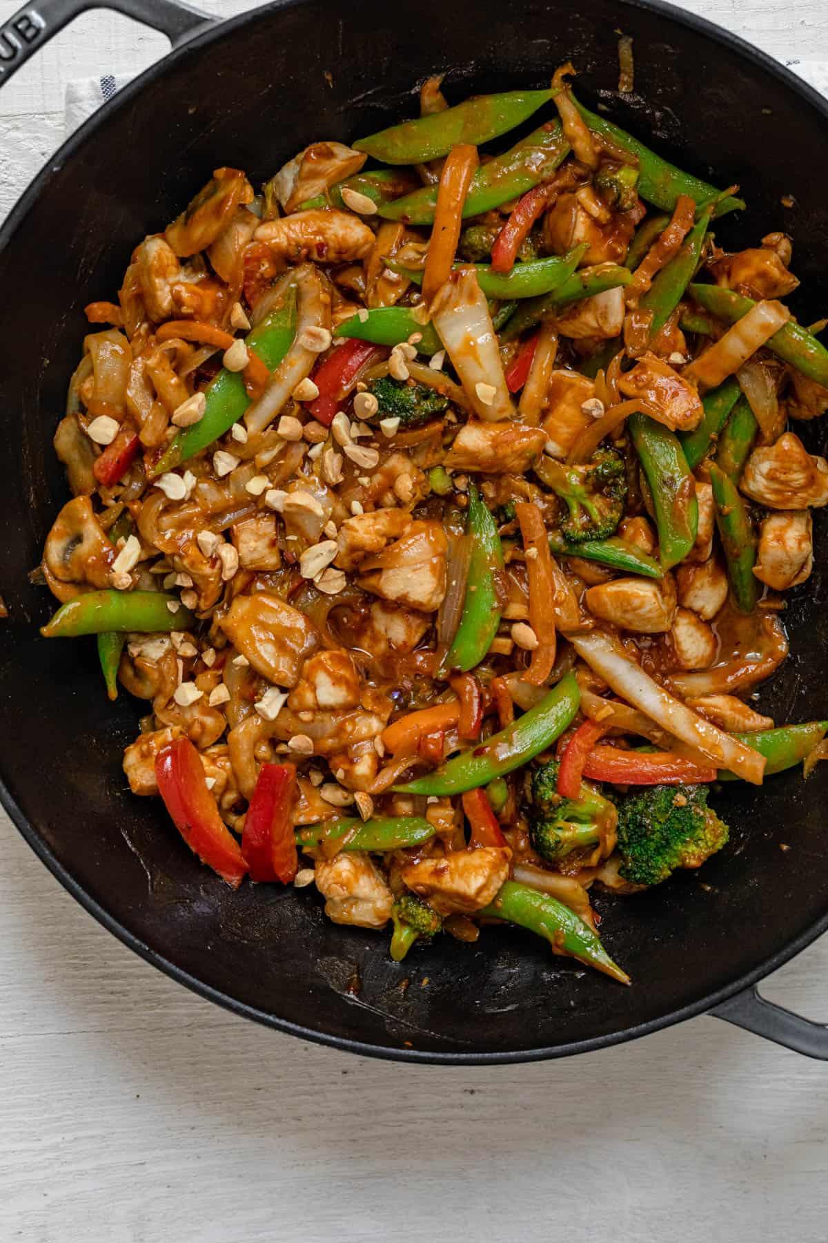 Large wok of thai peanut chicken stir fry