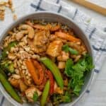 Thai peanut chicken stir fry serve in a bowl with brown rice