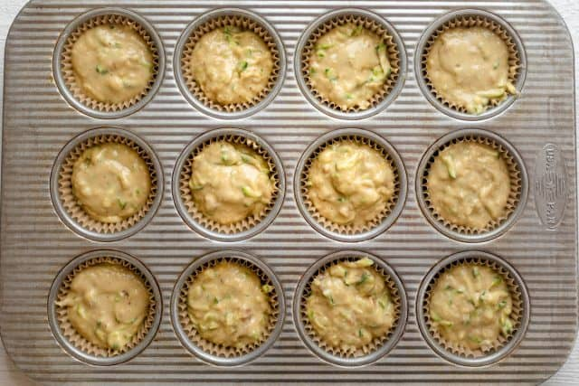 Batter transfered to muffin tin lined with parchment