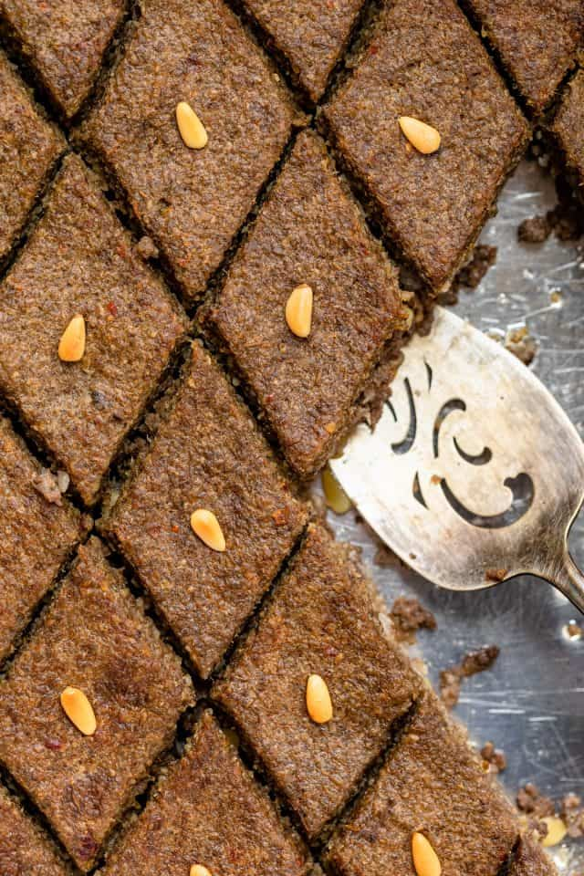 Close up shot of the kibbeh with spatula for serving