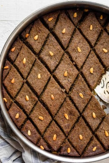 Baked kibbeh (also called kibbeh bil sanieh) topped with pine nuts