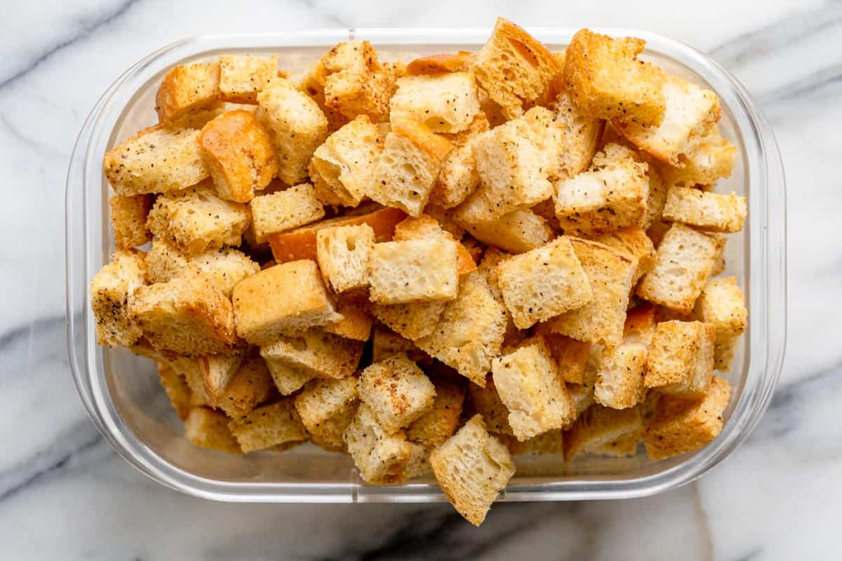Homemade croutons in a large rectangular container