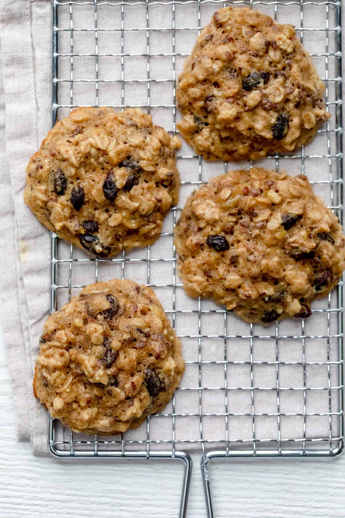 4 large oatmeal breakfast cookies on wire rack cooling
