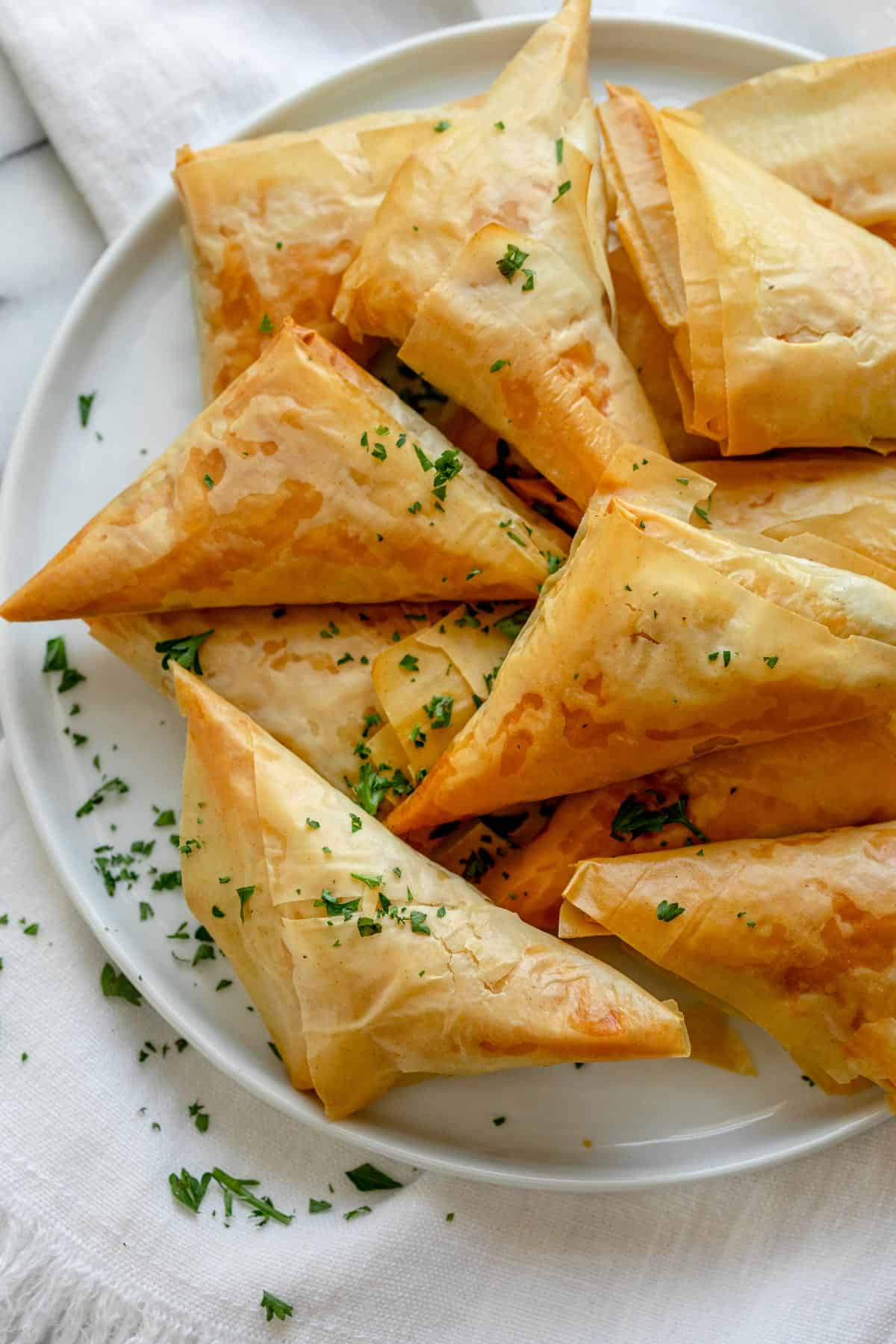Spanakopita triangles after baking on a plate