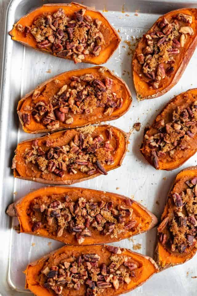 Twice baked sweet potatoes on a baking dish with parchment paper after baking