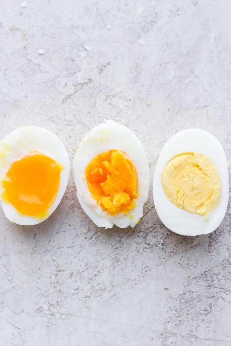 3 boiled eggs, soft, medium and hard - sliced in half to show consistency